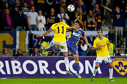 Jean Emanuel Beausejour Coliqueo of Birmingham City and Dejan Mezga of NK Maribor at 2nd Round of Europe League football match between NK Maribor (Slovenia) and Birmingham City (England), on September 29, 2011, in Maribor, Slovenia.  (Photo by Urban Urbanc / Sportida)