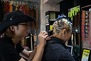"HIRO, The Epic Hair Artist <br /> <br /> In Osaka, Japan, lies a hair salon called ""Trick Store."" One of their artists, Hiro, has created some of the most cutting edge new styles simply by responding to his clients' requests. He creates hair styles that one can only call works of art along with his clients, cleverly using 3 different sized shavers and paint brushes, which are not typically used in hair styling. He has made styles based on a tomato, lizard, ladybug, goldfish, and more, and when he posted a picture of his tomato style online, the impact was such that it was shared worldwide.<br /> He has been invited to both China and Korea as a lecturer, and says he wants to work internationally in the future as well. It really is difficult to peel your eyes away from his boundary defying work. <br /> ©Exclusivepix Media"