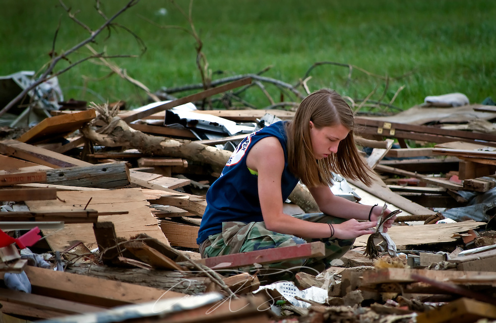 Taylor Ann Boozer sifts through the rubble of a demolished home May 15, 2011 in Smithville, Mississippi. Jesse Cox, 85, died in the house, and his wife, Nell Cox, 75, was seriously injured when an EF5 tornado swept through the town on April 27, 2011. (Photo by Carmen K. Sisson/Cloudybright)