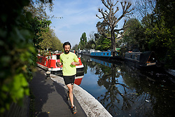 © Licensed to London News Pictures. 22/04/2019. London, UK. A jogger enjoying the warm temperatures in the early morning at Little Venice in London on what has been a record breaking Easter bank holiday weekend for temperatures. Photo credit: Ben Cawthra/LNP