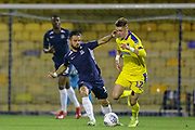 Southend United midfielder Stephen McLaughlin (11) battles for possession with AFC Wimbledon midfielder Jack Rudoni (12) during the EFL Trophy match between Southend United and AFC Wimbledon at Roots Hall, Southend, England on 13 November 2019.