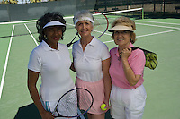 Three female tennis players, portrait