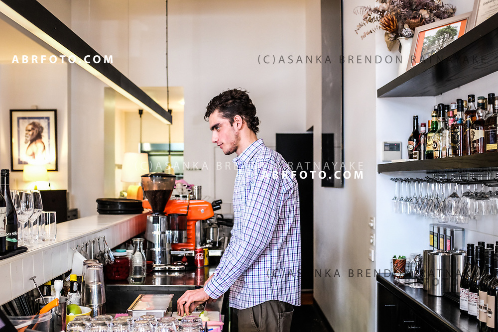 Daniel Guinane working at the front counter of the Charcoal Lane Restaurant on Gertrude Street in Melbourne, Australia, August 30, 2017. Daniel Guinane who is from the Yorta Yorta tribe has been doing his hospitality traineeship for over 6 months at Charcoal Lane. Asanka Brendon Ratnayake for the New York Times