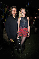 CLARA PAGET and OSCAR TUTTIETT at a party to celebrate the global launch of the Iconic Brazilian lifestyle brand Havaianas Wellies range held at Selfridges, Oxford Street, London on 14th April 2011.
