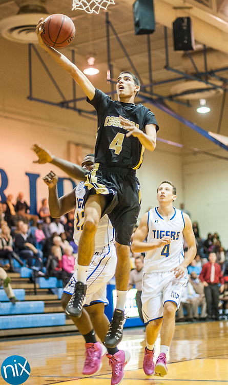 Concord's Ben Twigger goes up for a shot against Mount Pleasant Monday night at Mount Pleasant High School. The Spiders won the game 85-40.