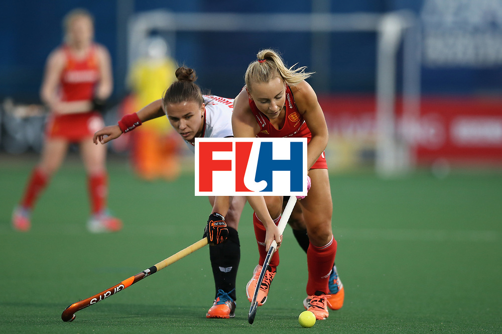 JOHANNESBURG, SOUTH AFRICA - JULY 10:  Hannah Martin of England and Paula Slawinska of Poland battle for possession during day 2 of the FIH Hockey World League Semi Finals Pool A match between England and Poland at Wits University on July 10, 2017 in Johannesburg, South Africa.  (Photo by Jan Kruger/Getty Images for FIH)