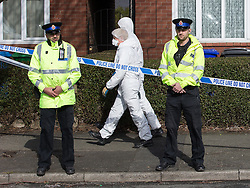 © Licensed to London News Pictures . 26/03/2015 . Manchester , UK . Forensic scenes of crime examiners search a house on Chain Road , Blackley , North Manchester as police in Manchester say they are investigating historical crimes . Approximately a dozen police and forensic examiners and eight police vehicles are deployed at the scene . Photo credit : Joel Goodman/LNP