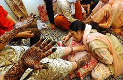 Henna is applied to the hands and feet of a bride before her engagement ceremony in Srinagar, the summer capital of Kashmir.