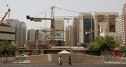 Abu Dhabi Construction.<br /> Cranes on a Construction site for new modern buildings in Hamden Street, Abu Dhabi, United Arab Emirates, <br /> 21st July 2008. <br /> Picture by Andrew Parsons / i-Images