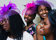 "June 25, 2016 - Marriah Willis (back, center), 12, is all smiles with Denise Stewart (purple hat), 13, as they ladies pose for a group picture during the second annual G.E.M.S. Tea Party at the Boling Center for Developmental Disabilities on Saturday. ""G.E.M.S. has taught me to be myself and have self-esteem and confidence,"" Willis said. The Shelby County Relative Caregiver Program at the University of Tennessee Health Science Center hosted the event for girls 12-17 enrolled in a mentoring group sponsored by the program. The Relative Caregiver Program is a collaboration with the Boling Center for Development Disabilities at UTHSC and the Tennessee Department of Children's Services. It was developed as a means to support children and teens who are being raised by their relatives because their parents are unable to do so. Founded in 2014, Girls Empowered and Mentored for Success (G.E.M.S.) educates and inspires girls through social activities and workshops. The program has grown from 17 girls in 2015 to 24 girls this year. (Yalonda M. James/The Commercial Appeal)"