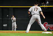 June 14 2011; Phoenix, AZ, USA; San Francisco Giants second basemen .Manny Burriss (2) gets the force out to first basemen Aubrey Huff (17) against the Arizona Diamondbacks at Chase Field. The Giants defeated the Diamondbacks 6-5.  Mandatory Credit: Jennifer Stewart-US PRESSWIRE..