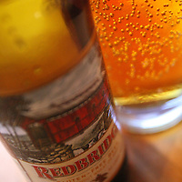 A bottle of Redbridge, a gluten-free beer, is photographed at Sammy's Woodfired Pizza in Palm Desert, Calif. on Thursday, May 6, 2010. The beer is made by Anheuser-Busch, Inc. using sorghum instead of wheat or barley. The restaurant, which is located at The Gardens on El Paseo, now offers vegetarian and gluten-free menu options. Crystal Chatham, The Desert Sun