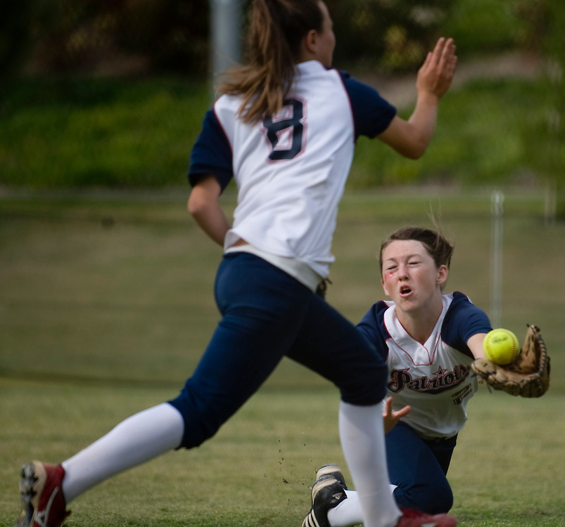 Beckman's Katie Denio nearly collides with teammate Cote Clark as she dives for the fly ball and makes the out during Thursday's game against Irvine.