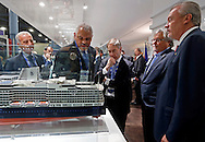 Cruise ship executives, Left to right, Vincenzo Petrone, Arnold Donald, David Dingle, Micky Arison and Stein Kruse look over a model of  a Holland America Line cruise ship during the Cruise Shipping Miami conference at the Miami Beach Convention Center on Tuesday, March 17, 2015.