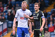 Bury Defender and loanee, Alex Whitmore (20) and Bristol Rovers Defender, Tom Lockyer (4) during the EFL Sky Bet League 1 match between Bury and Bristol Rovers at the JD Stadium, Bury, England on 19 August 2017. Photo by Mark Pollitt.