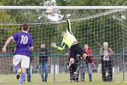 Litherland's keeper is beaten by the lob from Liverpool's Matthew Williams as City of Liverpool go three goals ahead in the North West Counties League Play Off Final match between Litherland REMYCA and City of Liverpool FC at Litherland Sports Park, Litherland, United Kingdom on 13 May 2017. Photo by Craig Galloway.