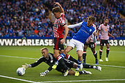 Sunderland Goalkeeper Jason Steele (1) saves from Sheffield Wednesday forward Sam Winnall (11)  during the EFL Sky Bet Championship match between Sheffield Wednesday and Sunderland at Hillsborough, Sheffield, England on 16 August 2017. Photo by Simon Davies.