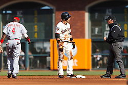 June 12, 2011; San Francisco, CA, USA;  San Francisco Giants center fielder Andres Torres (center) argues with MLB umpire Tim Tschida (4) after being called out at second base on a steal attempt during the first inning at AT&T Park.