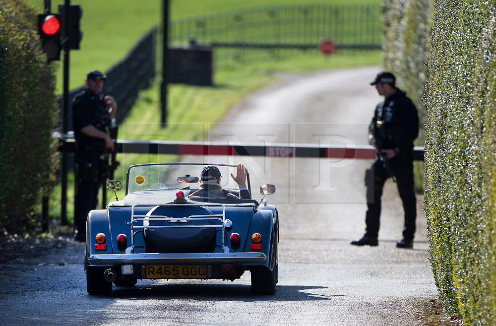 © Licensed to London News Pictures. 24/03/2019. Chequers , UK. Iain Duncan Smith, driving an open top Morgan sports car, waves at two armed police officers as he arrives at Chequers for a meeting with the Prime Minister. There have been reports of a cabinet revolt against Prime Minister Theresa May, over her handing of the Brexit negotiations. Photo credit: Peter Macdiarmid/LNP