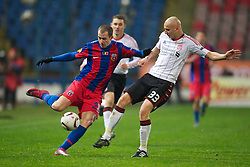 BUCHAREST, ROMANIA - Thursday, December 2, 2010: Liverpool's Jonjo Shelvey and FC Steaua Bucuresti's Bogdan Stancu during the UEFA Europa League Group K match at the Stadionul Steaua. (Pic by: David Rawcliffe/Propaganda)