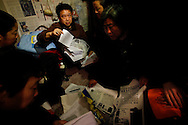 Chinese petitioners prepare written statements of their of their grievances in the cramp quarters they share, as they in hopes to have her case seen by the petitions office in  Beijing, China, Tuesday, March 3, 2009. Widespread frustration with the petition system is simmering and in several recent cases has boiled over, with a handful of people making desperate bids for attention. The peak season for the pilgrimages is the beginning of March, when China's lawmakers gather in the capital for their once-a-year legislative session. In an acknowledgement that the petition system is in crisis, China's Premier Wen Jiabao vowed to improve legal channels for grievances.