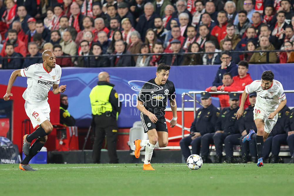 Manchester United Forward Alexis Sanchez battles with <br /> Sevilla midfielder Steven N'Zonzi (15) during the Champions League match between Sevilla and Manchester United at the Ramon Sanchez Pizjuan Stadium, Seville, Spain on 21 February 2018. Picture by Phil Duncan.