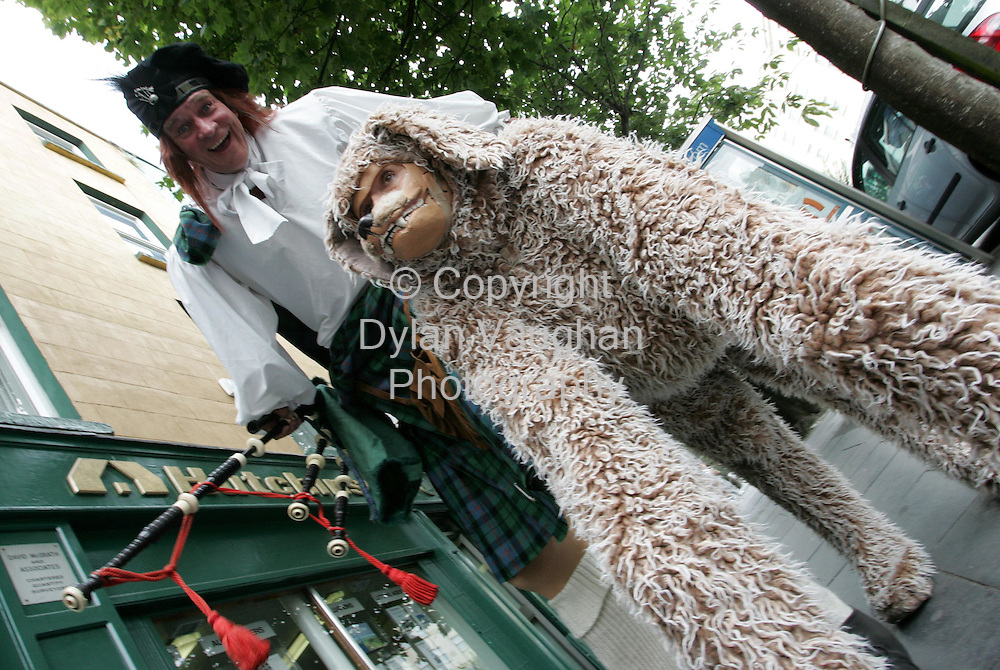 4/8/2006.Free Picture no charge for use .Pictured at the Spraoi Festival in Waterford yesterday were scottish performers Big Rory and Ochie the dog..The festival contiunes untill Sunday nights  street parade at 10pm..Picture Dylan Vaughan.