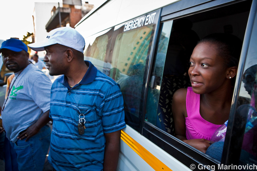 Zimbabwean Patience Musoni, 21(right)  waits to go home for christmas by mini bus taxi from central Johannesburg, Dec 17, 2009. Photo Greg Marinovich