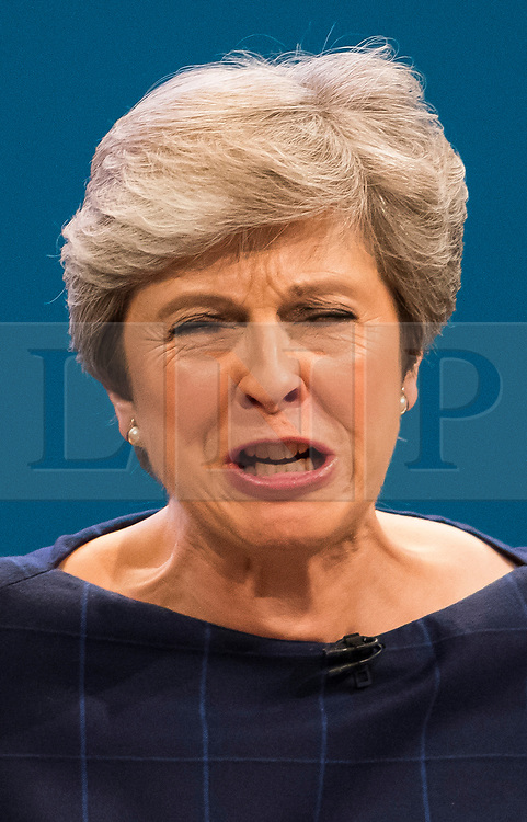 © Licensed to London News Pictures. 04/10/2017. Manchester, UK. British prime minister THERESA MAY delivers her leaders speech on the final day of the Conservative Party Conference. The four day event is expected to focus heavily on Brexit, with the British prime minister hoping to dampen rumours of a leadership challenge. Photo credit: Ben Cawthra/LNP