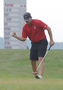 Grosse Ile amateur Steven Cuzzort celebrates after making birdie on the 16th hole of Boyne Mountains Alpine course during final round regulation play at the 2009 Michigan PGA Tournament of Champions.