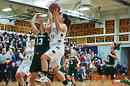 Essex's Muchaela Harton (32) leaps past St. Johnsbury's Gunnhidur Atladottir (13) for a lay up during the girls basketball game between the St. Johnsbury Hilltoppers and the Essex Hornets at Essex high school on Tuesday night January 5, 2016 in Essex. (BRIAN JENKINS/for the FREE PRESS)