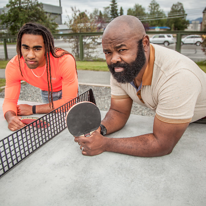 Clinical Theropist Kirklin Kinney with his engineering student son, Ahanu, between games at the cement ping pong table at Minnesota Park in mid-town Anchorage.  hakirklinkinney@gmail.com