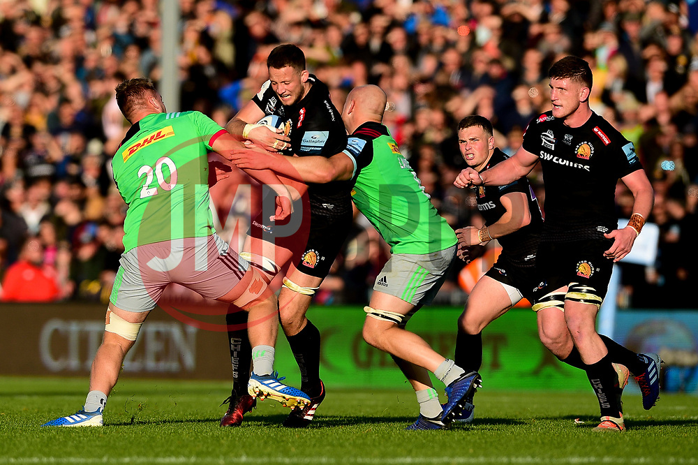 Jonny Hill of Exeter Chiefs is tackled by Alex Dombrandt of Harlequins - Mandatory by-line: Ryan Hiscott/JMP - 19/10/2019 - RUGBY - Sandy Park - Exeter, England - Exeter Chiefs v Harlequins - Gallagher Premiership Rugby