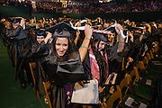 Ohio University students move their tassel left side to of their mortarboard to signify their completion of their degree at commencement Saturday May 3, 2014..  Photo by Ohio University / Jonathan Adams