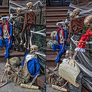 Halloween skeleton decoration on side of brownstone in Greenwich Village, NYC.