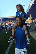 Joe Thompson and his daughter escapes the crowds on the pitch to celebrate  during the EFL Sky Bet League 1 match between Rochdale and Charlton Athletic at Spotland, Rochdale, England on 5 May 2018. Picture by Daniel Youngs.