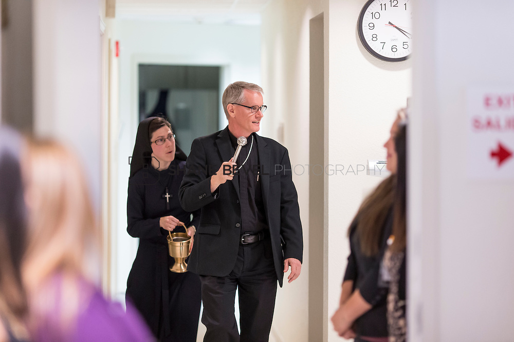 9/29/16 4:21:03 PM --  Bishop David Konderla blesses the newly remodeled Xavier Clinic in east Tulsa. <br /> <br /> Photo by Shane Bevel