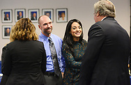 Finalists Domenick Renzi (2nd from left) and Mimma-Marie Cammarata (3rd from left) are congratulated by state board of education members Kimberley Harrington (left) and Andrew Mulvihill (right) before the Teacher of the Year announcement Wednesday, October 04, 2017 at the New Jersey Department of Education in Trenton, New Jersey. (WILLIAM THOMAS CAIN / For The Philadelphia Inquirer)