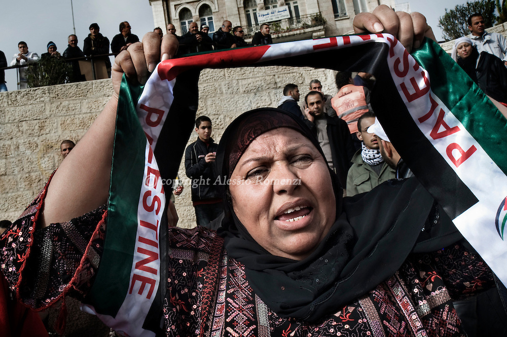 JERUSALEM : Palestinian woman demonstrate in front of Damascus Gate in Jerusalem's Old City during a demonstration on December 17, 2009 against an Israeli ban on Palestinian events in the disputed holy city, which is seen by the Jewish state as its 'eternal, undivided' capital. Israeli police also surrounded the French cultural centre in mostly Arab east Jerusalem, apparently to detain the organiser of a Palestinian cultural event. Around 50 people, including officials from the West Bank-based Palestinian Authority (PA) were taking part in the event at the centre in honour of Jerusalem's selection as the 2009 'capital of Arab culture' by UNESCO and the Arab League..© ALESSIO ROMENZI
