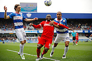 Charlton Athletic striker Igor Vetokele (14) takes the ball down despite Queens Park Rangers midfielder Karl Henry (20)  holding him during the Sky Bet Championship match between Queens Park Rangers and Charlton Athletic at the Loftus Road Stadium, London, England on 9 April 2016. Photo by Andy Walter.