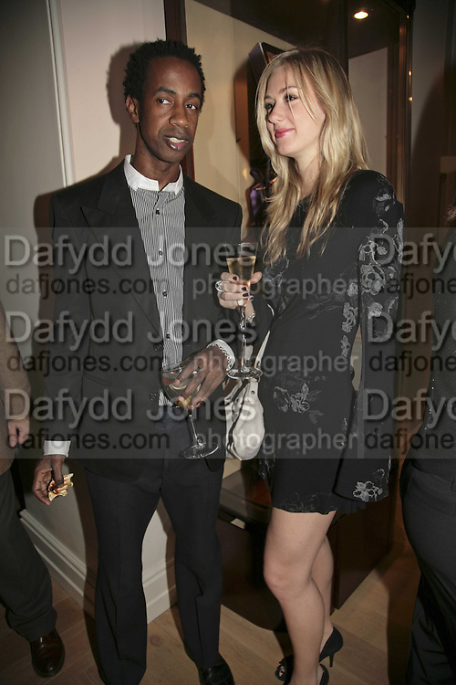 Mo and Alexandra Rich, THE CHRISTMAS PARTY CELEBRATING THE 225TH ANNIVERSARY OF ASPREY. 167 NEW BOND ST. LONDON W1. 7 DECEMBER 2006. ONE TIME USE ONLY - DO NOT ARCHIVE  © Copyright Photograph by Dafydd Jones 248 CLAPHAM PARK RD. LONDON SW90PZ.  Tel 020 7733 0108 www.dafjones.com