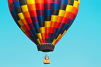 Rainbow Hot Air Balloon image for sale, The hot air balloon is the oldest successful human-carrying flight technology. It is part of a class of aircraft known as balloon aircraft. On November 21, 1783, in Annonay, France, the first untethered[1] manned flight was performed by Jean-Fran&ccedil;ois Pil&acirc;tre de Rozier and Fran&ccedil;ois Laurent d'Arlandes in a hot air balloon created on December 14, 1782 by the Montgolfier brothers.[2] Hot air balloons that can be propelled through the air rather than just being pushed along by the wind are known as airships or, more specifically, thermal airships.<br />  <br /> A hot air balloon consists of a bag called the envelope that is capable of containing heated air. Suspended beneath is a gondola or wicker basket (in some long-distance or high-altitude balloons, a capsule), which carries passengers and (usually) a source of heat,