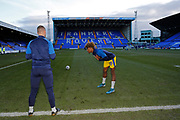 Ossama Ashley of Wimbledon warming up during the EFL Sky Bet League 1 match between Tranmere Rovers and AFC Wimbledon at Prenton Park, Birkenhead, England on 21 December 2019.