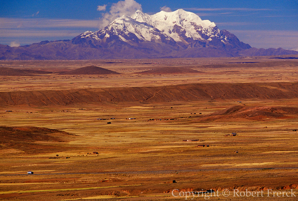BOLIVIA, ALTIPLANO view across the 14,000 foot high altiplano toward Illimani Mountain, 6439m, in the  Cordillera Real range south of La Paz