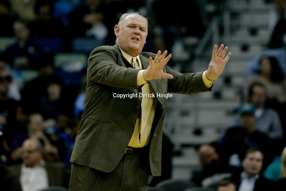 Dec 18, 2009; New Orleans, LA, USA; Denver Nuggets head coach George  Karl reacts to an officials call during the first half against the New Orleans Hornets at the New Orleans Arena. Mandatory Credit: Derick E. Hingle-US PRESSWIRE