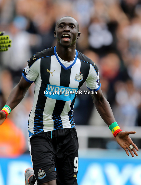 Newcastle United's Papiss Demba Cisse celebrates scoring his side's first goal of the game during the Barclays Premier League match at St James' Park, Newcastle.