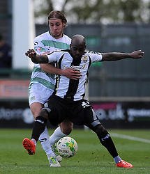 Jamal Campbell-Ryce of Notts County is tackled by Yeovil Town's Sam Foley - Photo mandatory by-line: Harry Trump/JMP - Mobile: 07966 386802 - 11/04/15 - SPORT - FOOTBALL - Sky Bet League One - Yeovil Town v Notts County - Huish Park, Yeovil, England.