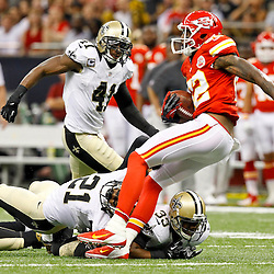 September 23, 2012; New Orleans, LA, USA; New Orleans Saints cornerback Patrick Robinson (21) and cornerback Jabari Greer (33) combine to tackle Kansas City Chiefs wide receiver Dwayne Bowe (82) during the second quarter of a game at the Mercedes-Benz Superdome. Mandatory Credit: Derick E. Hingle-US PRESSWIRE