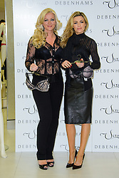 Michelle Mone and Abbey Clancy pose for Ultimo Photocall. London, United Kingdom. Tuesday, 11th February 2014. Picture by Chris Joseph / i-Images
