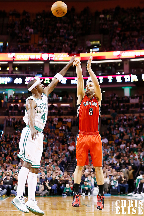 17 November 2012: Toronto Raptors point guard Jose Calderon (8) takes a jumpshot over Boston Celtics shooting guard Jason Terry (4) during the Boston Celtics 107-89 victory over the Toronto Raptors at the TD Garden, Boston, Massachusetts, USA.